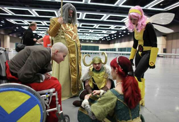 Contestants wait backstage during the Emerald City Comicon costume contest on Saturday, March 31, 2012. The annual comic book and pop culture convention is the largest such convention in the Pacific Northwest. Photo: JOSHUA TRUJILLO / SEATTLEPI.COM