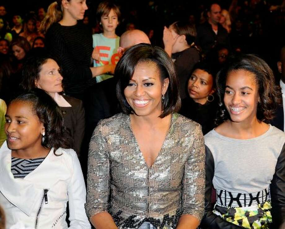 (L-R) Sasha Obama, First Lady Michelle Obama and Malia Obama at Nickelodeon's 25th Annual Kids' Choice Awards held at Galen Center on March 31, 2012 in Los Angeles, California.