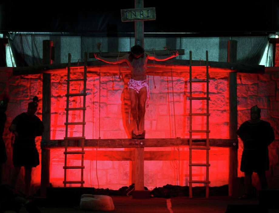 Jesus, played by Mark Thompson, is crucified during the Easter pageant held at Concordia Lutheran Church. Photo: Jerry Lara, San Antonio Express-News / © San Antonio Express-News