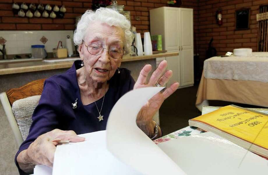 Verla Morris, who will turn 100 later this year, goes through some of her family census data from the 19th and 20th centuries at her local residential senior center in Chandler, Ariz. Photo: Associated Press