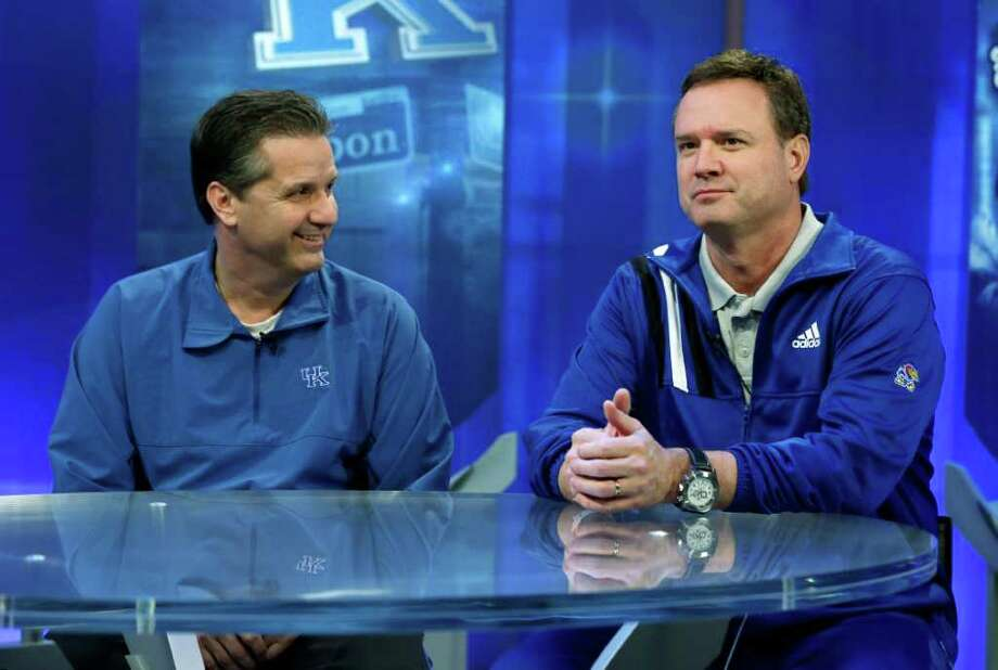 Kentucky coach John Calipari (left) and Kansas coach Bill Self appear during a TV interview ahead of tonight's title game. Photo: AP