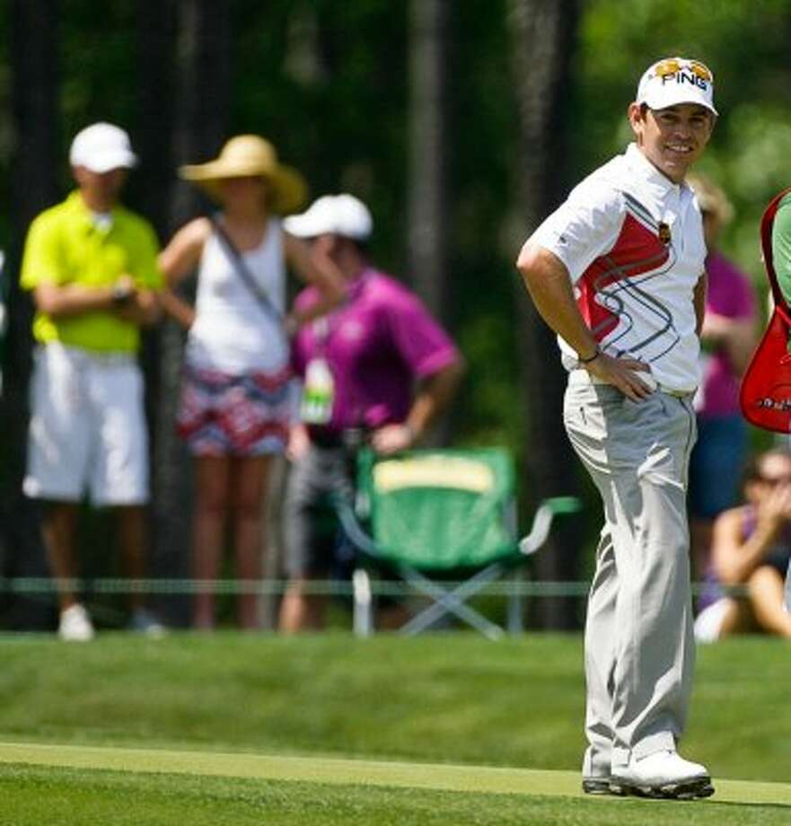 Louis Oosthuizen smiles at the gallery after making a long putt. (Nick de la Torre / Chronicle)