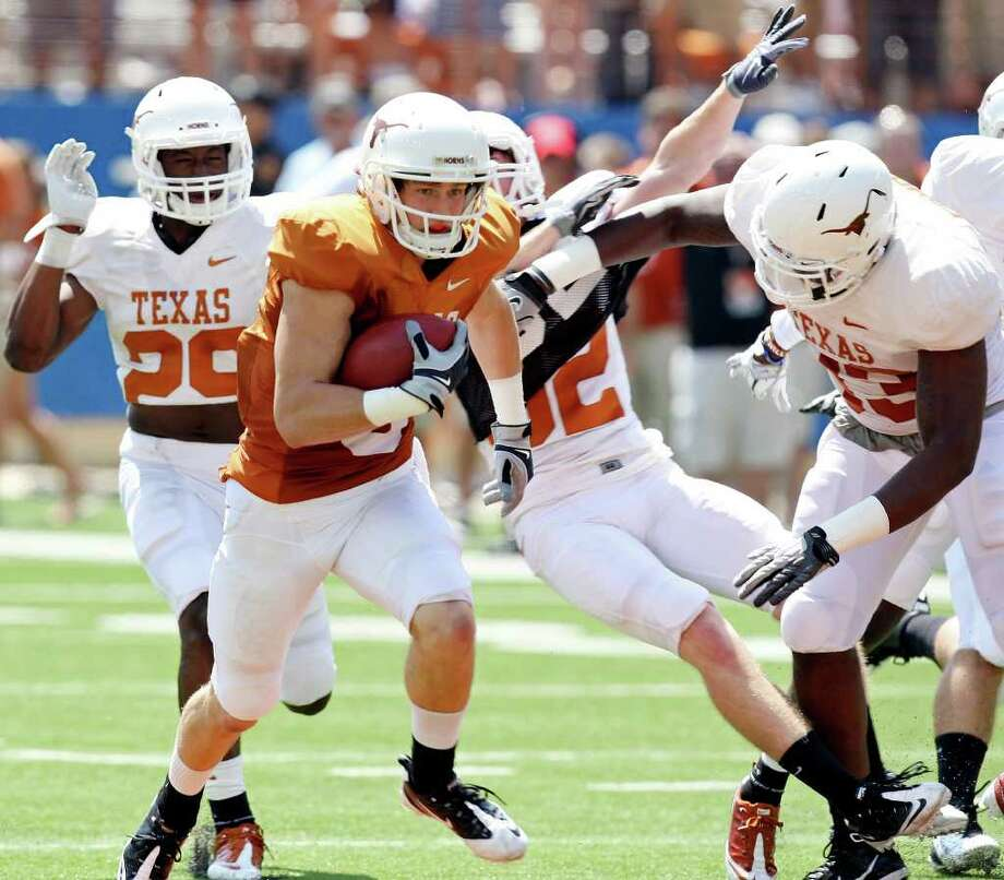 Receiver Jaxon Shipley (second from left), heading upfield in Texas' spring game, may have outdone the QBs with a 54-yard TD toss to D.J. Grant. Photo: Edward A. Ornelas, San Antonio Express-News / © SAN ANTONIO EXPRESS-NEWS (NFS)