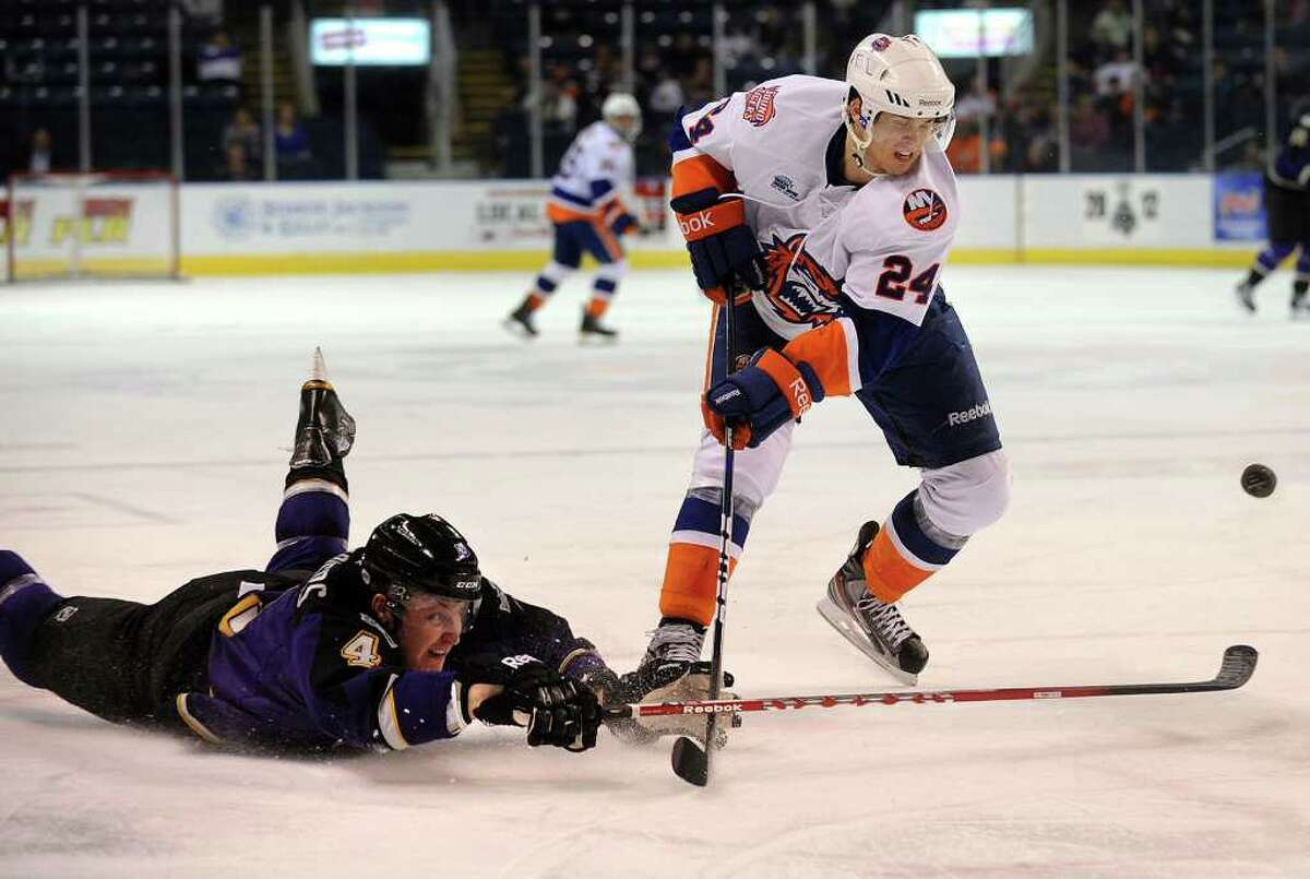Manchester's Nick Deslauriers, left, dives to knock the puck away from Sound Tiger David Ullstrom during their AHL matchup at the Webster Bank Arena in Bridgeport on Sunday, April 1, 2012. The Sound Tigers won the game in overtime 3-2.