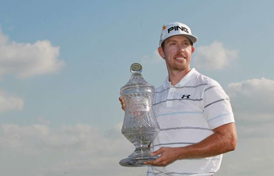 Final round: April 1 Hunter Mahan poses for a picture with the Shell Houston