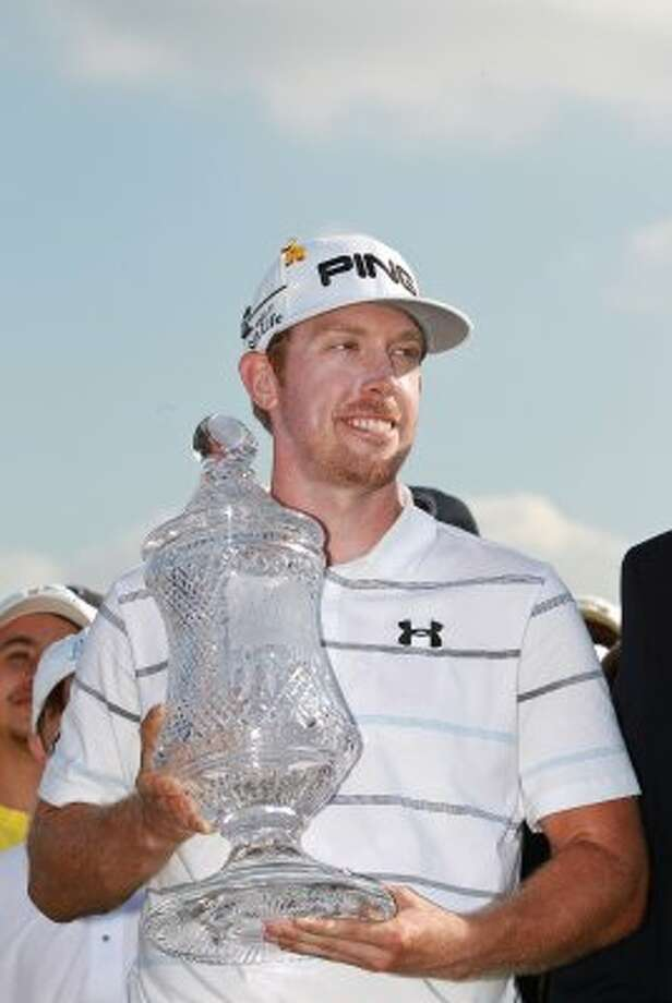 Hunter Mahan poses for a picture with the Shell Houston Open trophy. (Nick de la Torre / Houston Chronicle)