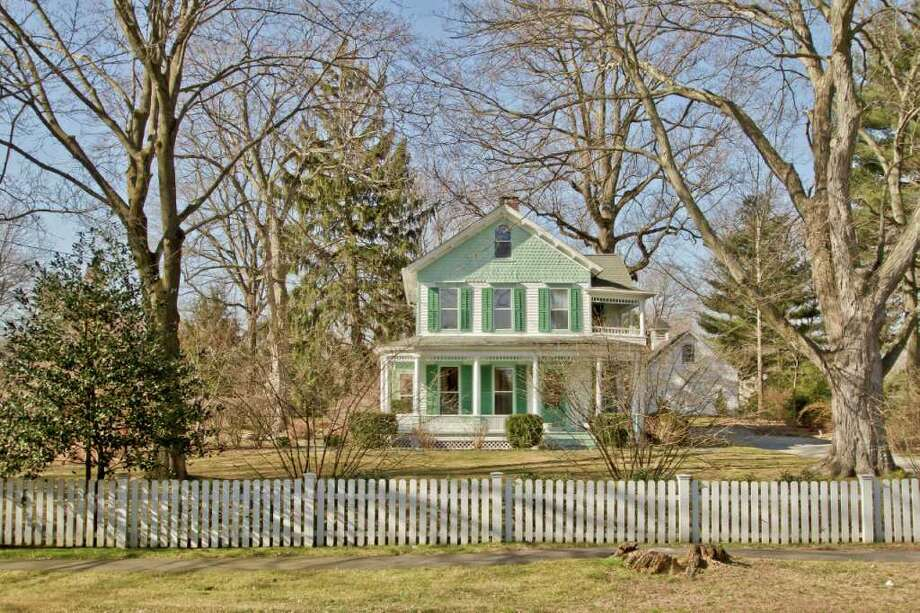 This vintage colonial farmhouse at 113 North Ave., built in the late 19th century, has caught the eye of passersby with its inviting appeal as a true example of Americana. Photo: Rob Staub, Contributed Photo/Rob Staub / WWW.RobStaubphoto.com