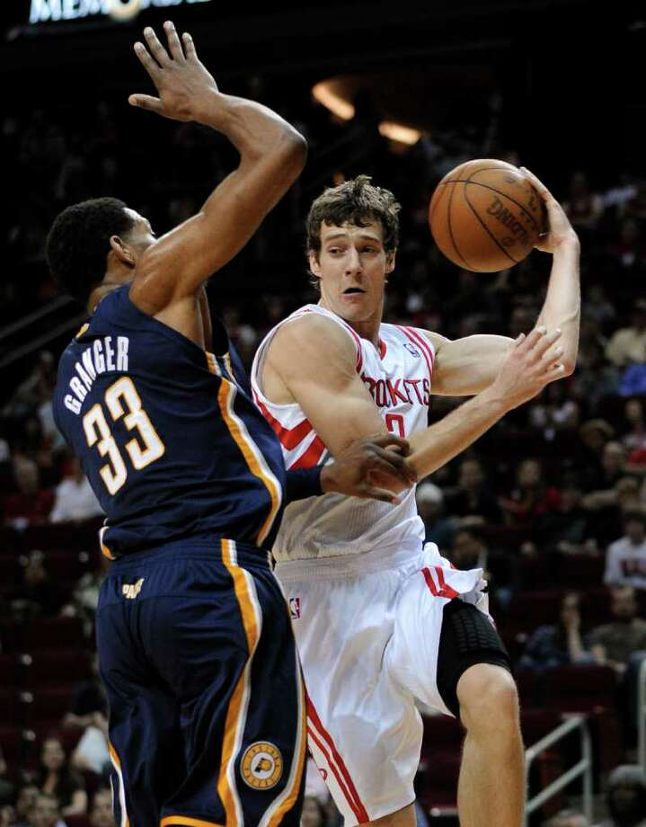 Houston Rockets' Goran Dragic (3) looks to pass the ball around Indiana Pacers' Danny Granger (33) in the first half of an NBA basketball game Sunday, April 1, 2012, in Houston. (AP Photo/Pat Sullivan) Photo: Pat Sullivan, Associated Press / AP