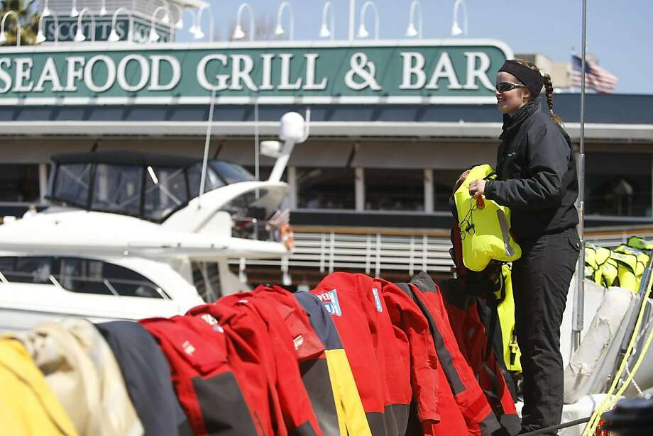 """Rachel Chapman, from England,  has been sailing on the """"I Love New York"""" boat since the very beginning. Here Rachel hangs all the jackets and life vests to dry. Jack London Square is host to the Clipper Round the World Race 2011-2012. Boats began docking on Friday, March 30, 2012 and continued  arriving on Sunday, April 1, 2012. Photo: Sean Culligan, The Chronicle"""