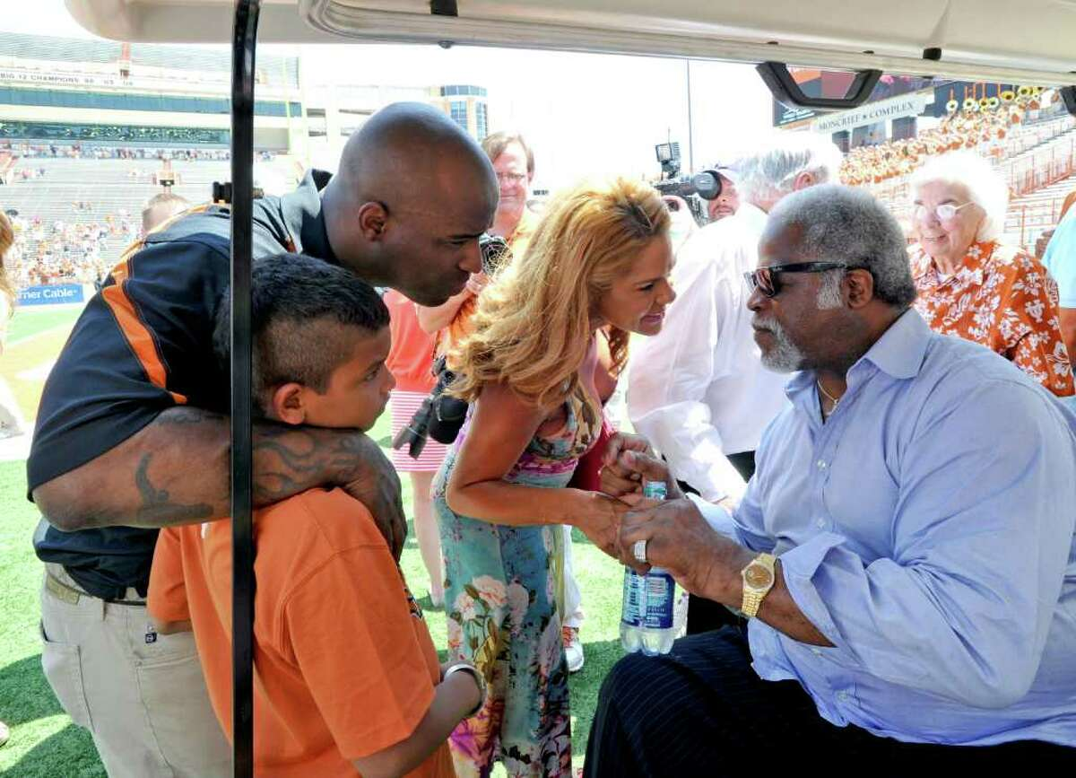 UT football greats Earl Campbell (right) and Ricky Williams will have their names on the field at the Longhorns' home stadium after changes announced by the school Monday following demands for change by Black student-athletes.