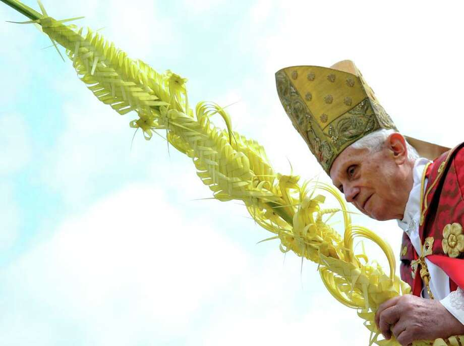 Pope Benedict XVI attends the Palm Sunday celebration at Saint Peter's square at the Vatican, on April 1, 2012. The Palm Sunday marks the holy week of Easter in celebration of the crucifixion and resurrection of Jesus Christ. Photo: GABRIEL BOUYS, AFP/Getty Images / AFP