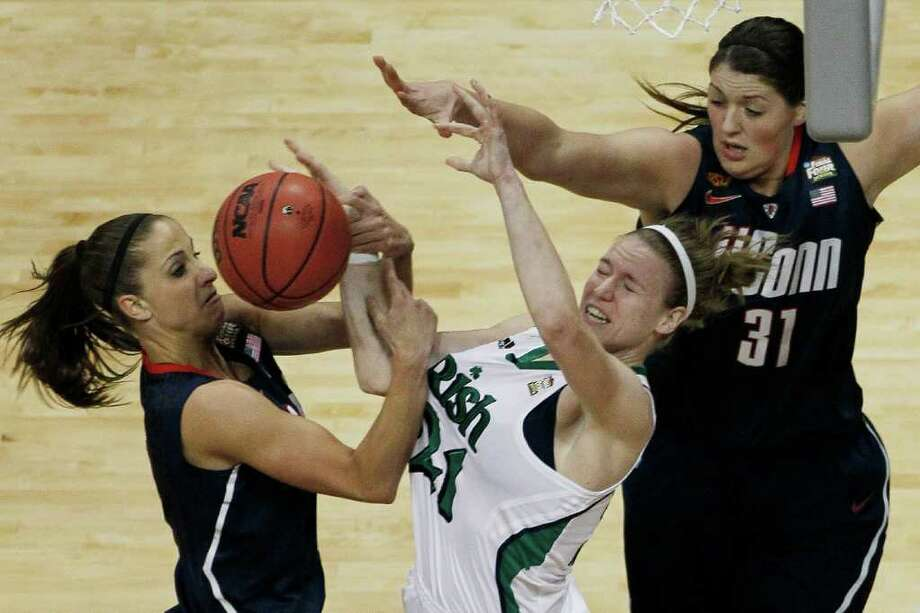 Connecticut guard Caroline Doty (5) Notre Dame guard Fraderica Miller (12) Connecticut center Stefanie Dolson (31) work for rebound during the first half of the NCAA women's Final Four semifinal college basketball game, in Denver, Sunday, April 1, 2012. Photo: David Zalubowski