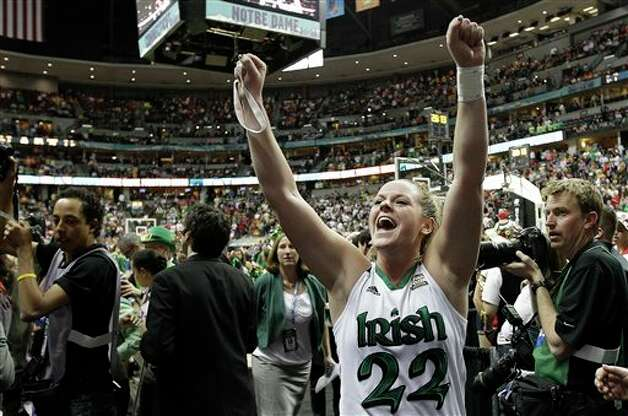 Notre Dame guard Brittany  Mallory (22) celebrates victory after an NCAA women's Final Four  semifinal college basketball game against UConn in Denver, Sunday, April 1, 2012. Notre Dame won 83-75. (AP Photo/Eric Gay)