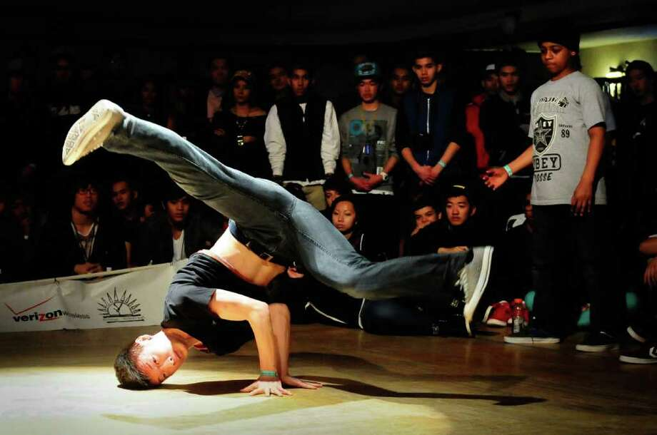 A breaker concentrates as he spins on his head during the finals of The Northwest Sweet 16 breakdancing competition at Washington Hall in Seattle on Saturday, March 31, 2012. In its 5th year, The Northwest Sweet 16 is the largest breakdancing competition in the region and hosts the best b-boys and b-girls from all over the country. Breakdancers competed for cash prizes and trophies in 1-on-1 and 5-on-5 battles during the finals. Photo: LINDSEY WASSON / SEATTLEPI.COM