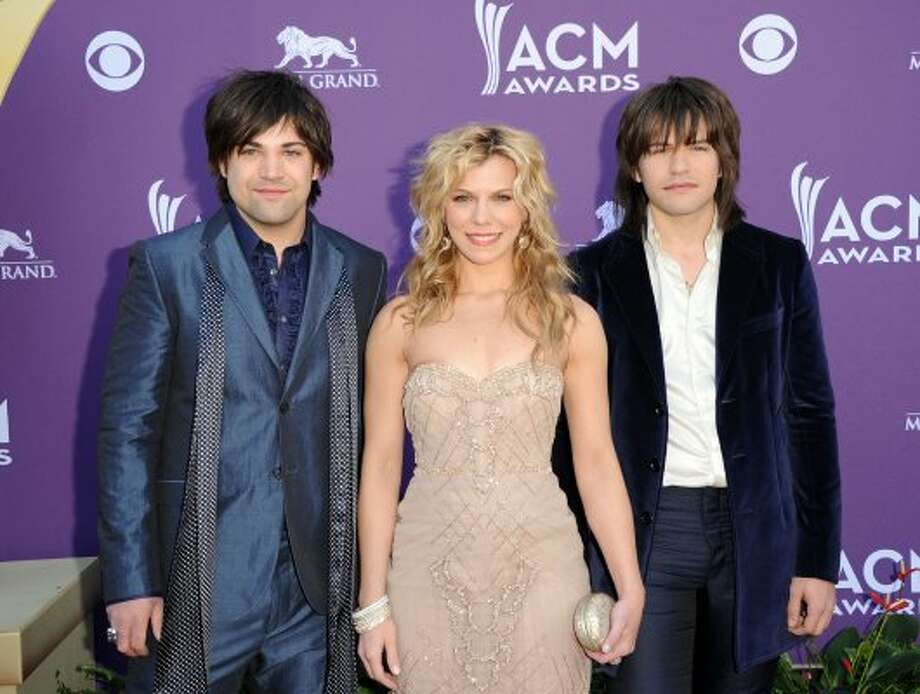 LAS VEGAS, NV - APRIL 01:  (L-R)  Musicians Neil Perry, Kimberly Perry and Reid Perry of The Band Perry arrive at the 47th Annual Academy Of Country Music Awards held at the MGM Grand Garden Arena on April 1, 2012 in Las Vegas, Nevada.  (Photo by Jason Merritt/Getty Images) (Jason Merritt / Getty Images)