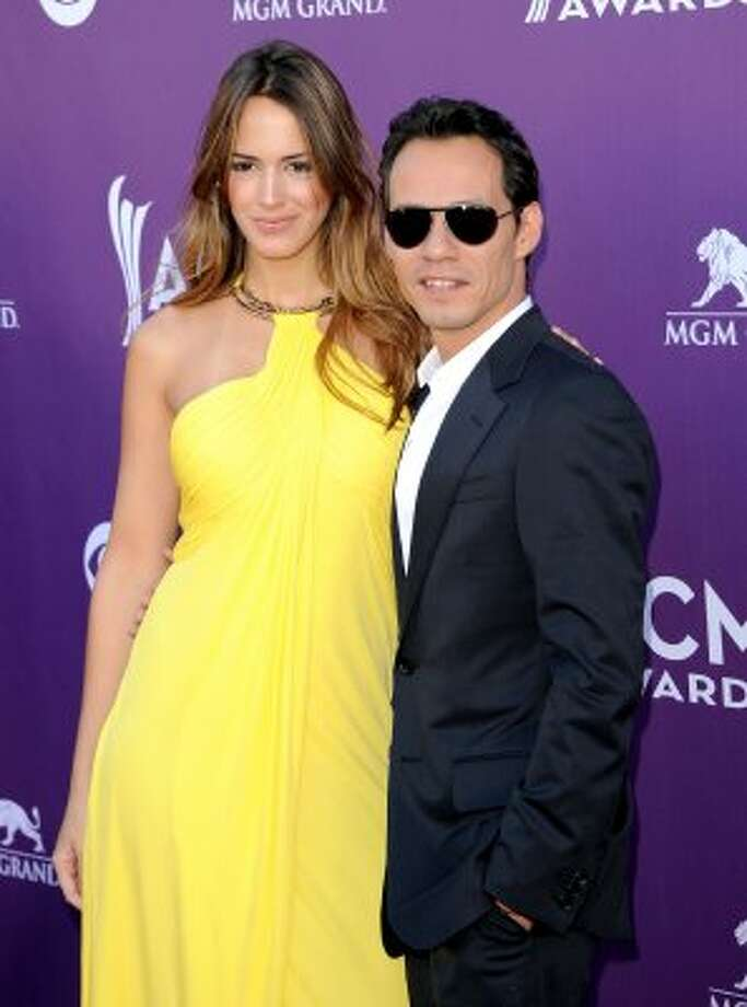 LAS VEGAS, NV - APRIL 01:  Singer Marc Anthony (R) and Shannon de Lima arrive at the 47th Annual Academy Of Country Music Awards held at the MGM Grand Garden Arena on April 1, 2012 in Las Vegas, Nevada.  (Photo by Jason Merritt/Getty Images) (Jason Merritt / Getty Images)