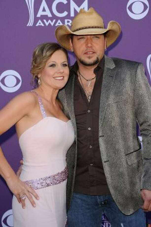 LAS VEGAS, NV - APRIL 01:  Singer Jason Aldean (R) and Jessica Aldean arrive at the 47th Annual Academy Of Country Music Awards held at the MGM Grand Garden Arena on April 1, 2012 in Las Vegas, Nevada.  (Photo by Jason Merritt/Getty Images) (Jason Merritt / Getty Images)