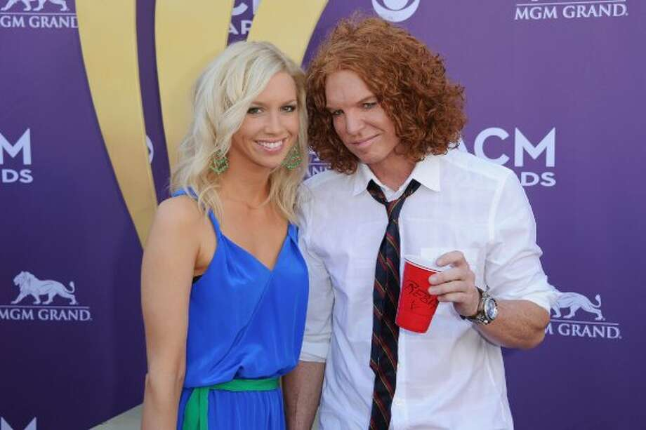LAS VEGAS, NV - APRIL 01:  Comedian Carrot Top (R) and Amanda Hogan arrive at the 47th Annual Academy Of Country Music Awards held at the MGM Grand Garden Arena on April 1, 2012 in Las Vegas, Nevada.  (Photo by Jason Merritt/Getty Images) (Jason Merritt / Getty Images)