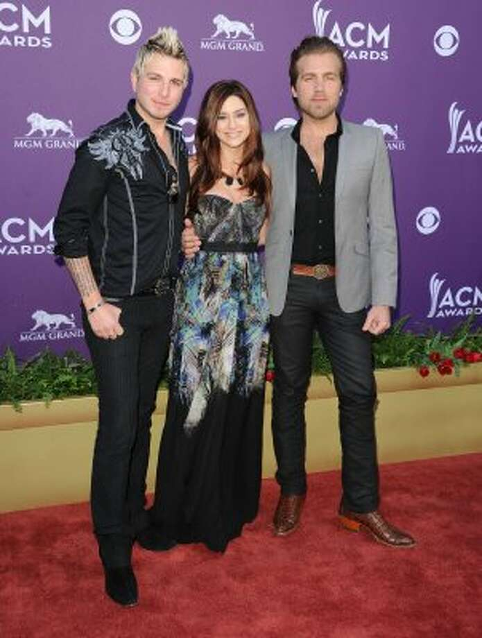LAS VEGAS, NV - APRIL 01:  Musicians Mike Gossin, Rachel Reinert, and Tom Gossin of Gloriana arrive at the 47th Annual Academy Of Country Music Awards held at the MGM Grand Garden Arena on April 1, 2012 in Las Vegas, Nevada.  (Photo by Jason Merritt/Getty Images) (Jason Merritt / Getty Images)