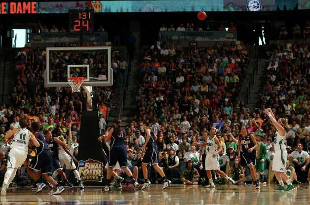 DENVER, CO - APRIL 01:  Brittany Mallory #22 of the Notre Dame Fighting Irish makes a 3-point shot to give Notre Dame Fighting Irish a 76-72 lead in overtime against the Connecticut Huskies during the National Semifinal game of the 2012 NCAA Division I Women's Basketball Championship at Pepsi Center on April 1, 2012 in Denver, Colorado.  (Photo by Doug Pensinger/Getty Images) Photo: Doug Pensinger, Getty Images / 2012 Getty Images