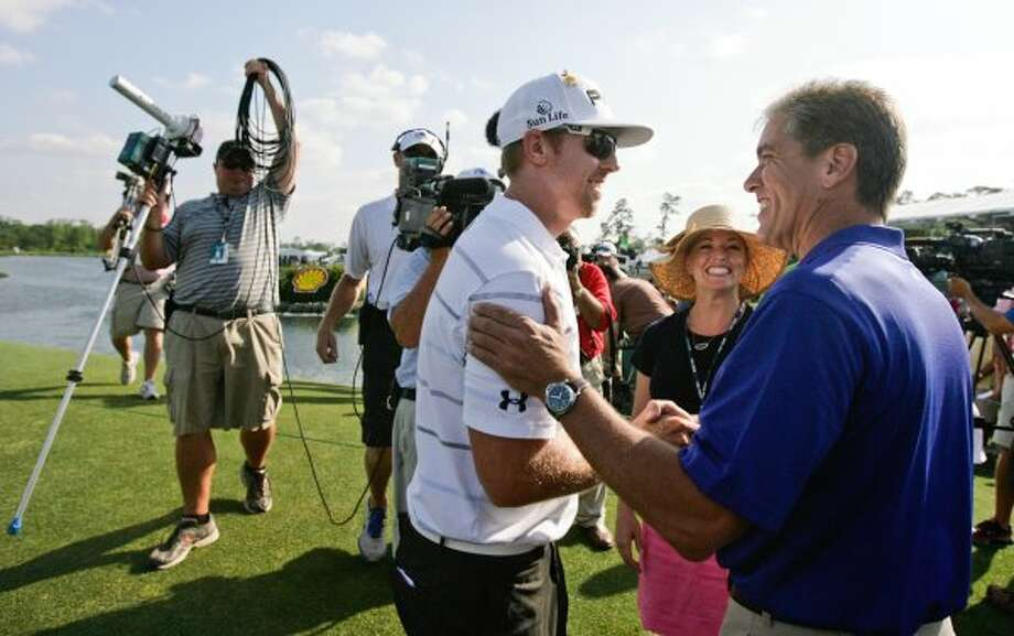 Hunter Mahan, left, shakes hands with Shell President Marvin E. Odum after winning the Shell Houston Open. (Nick de la Torre / Houston Chronicle)
