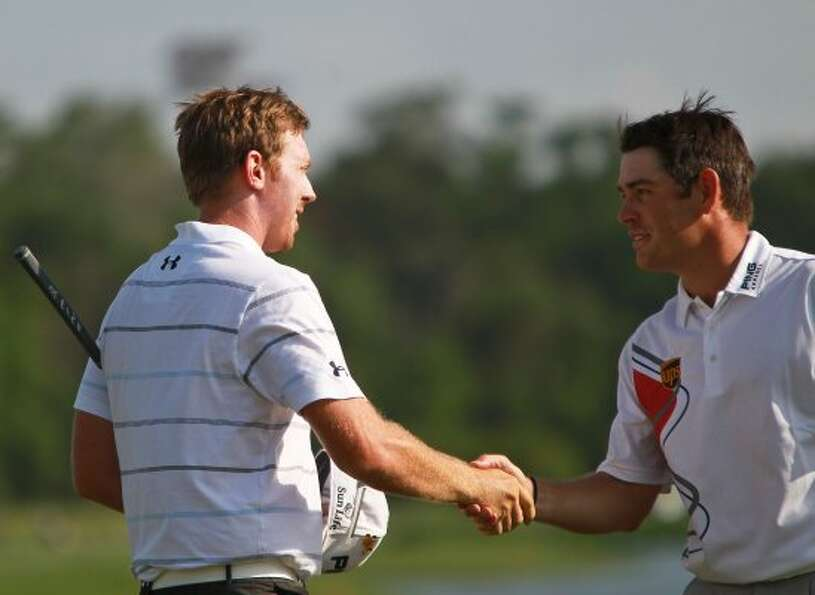 Hunter Mahan, left, shakes hands with his playing partner Louis Oothuize after winning the Shell Hou