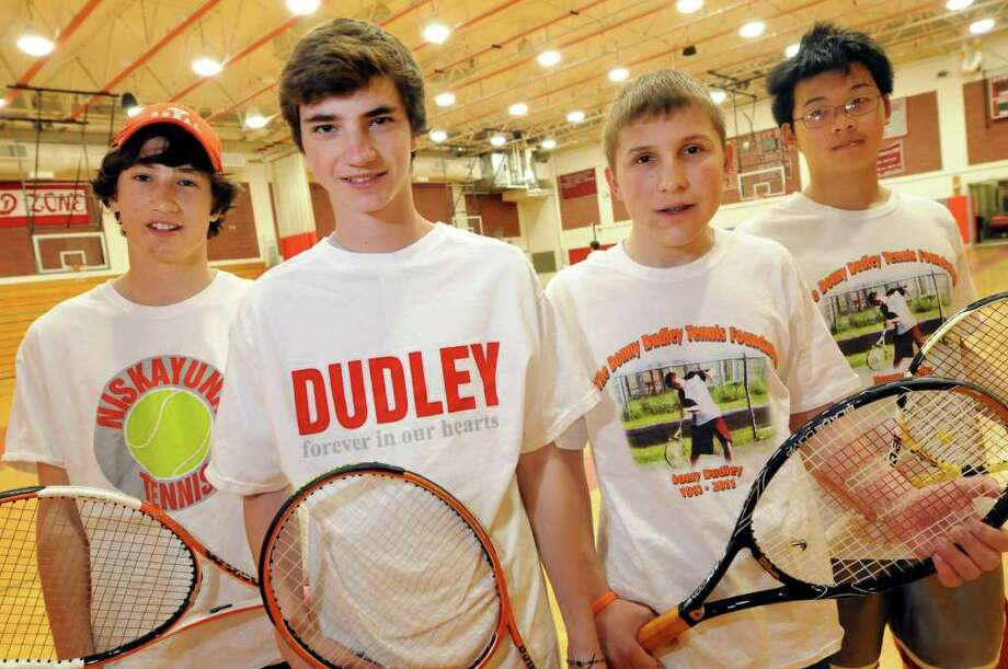 Members of the varsity tennis team wear T-shirts honoring former teammate Donny Dudley during practice on Thursday, March 29, 2012, at Niskayuna High in Niskayuna N.Y. Dudley was killed in a car crash this past summer. From left are Jacob Leighton, 17, Zack Valenza, 17, Nikolas Dobies, 17, and Russell Santos, 15. (Cindy Schultz / Times Union) Photo: Cindy Schultz / 00017006A