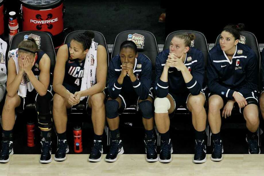 Connecticut players watch action at the end of overtime in the NCAA women's Final Four semifinal college basketball game against Notre Dame, in Denver, Sunday, April 1, 2012. Notre Dame won 83-75. (AP Photo/David Zalubowski) Photo: David Zalubowski, Associated Press / AP