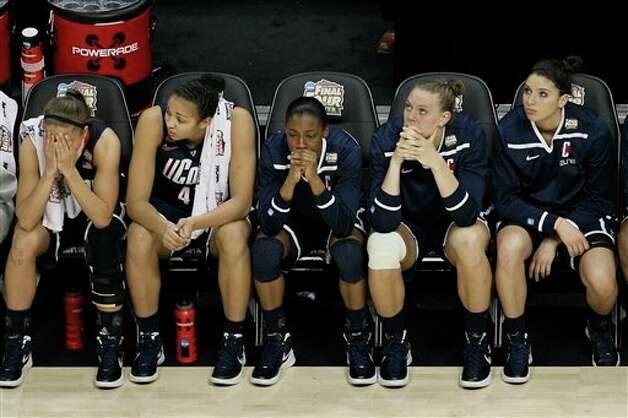 UConn players watch action at the end of overtime in the NCAA women's Final  Four semifinal college basketball game against Notre Dame, in Denver,  Sunday, April 1, 2012. Notre Dame won 83-75. (AP Photo/David Zalubowski)