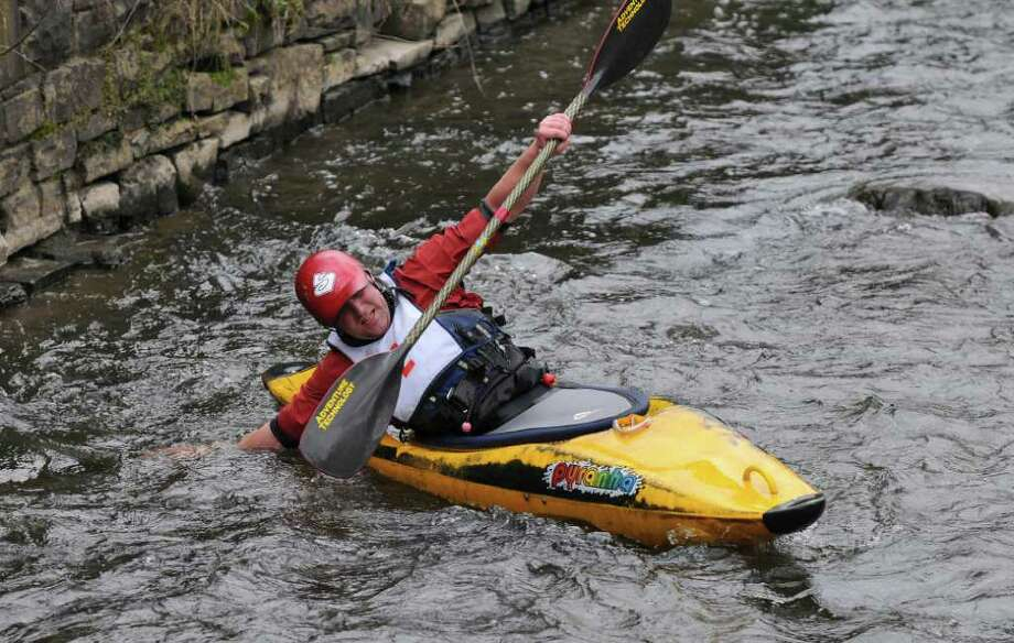 Ben Monast of Melrose tries to push off in shallow water during the 39th annual Tenandeho White Water Derby on Sunday April 1, 2012 in Mechanicville, NY. A race official said the water was at the lowest level he'd seen for this time of year. Over 30 boats entered the derby. (Philip Kamrass / Times Union ) Photo: Philip Kamrass / 00016802A