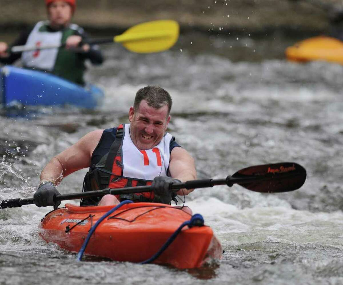Joseph Pickett of Saratoga Springs navigates the rapids during the 39th annual Tenandeho White Water Derby on Sunday April 1, 2012 in Mechanicville, NY. A race official said the water was at the lowest level he'd seen for this time of year. Over 30 boats entered the derby. (Philip Kamrass / Times Union )