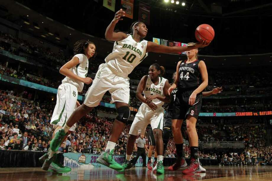 Destiny Williams #10 of the Baylor Bears controls a rebound in the first half against the Stanford Cardinal during the National Semifinal game of the 2012 NCAA Division I Women's Basketball Championship at Pepsi Center on April 1, 2012 in Denver, Colorado. Photo: Doug Pensinger, Getty Images / 2012 Getty Images