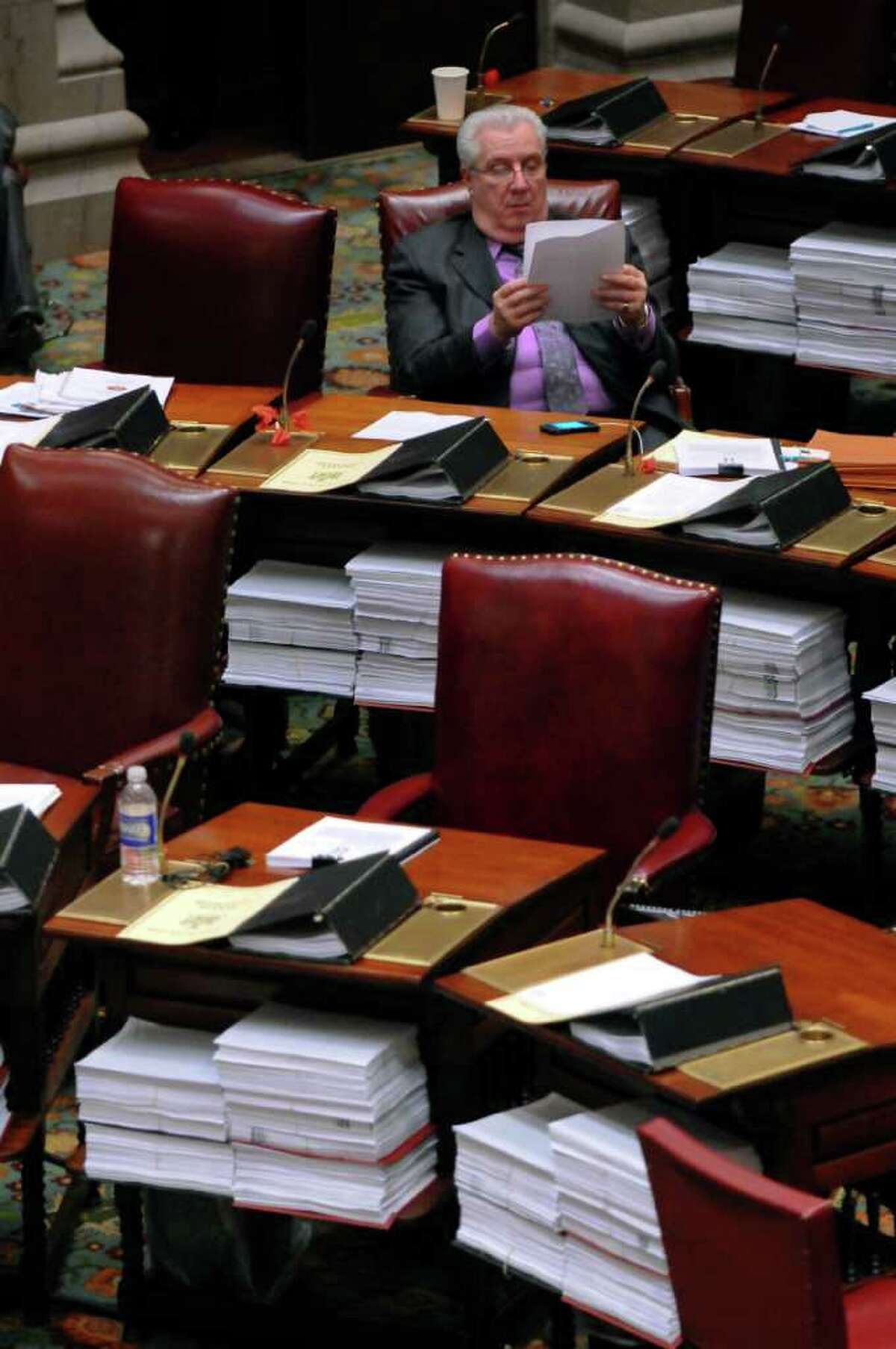 State Senator Carl L. Marcellino, a member of the Republican majority, reads on the floor of the Senate chamber at about 9 p.m. on Wednesday night March 14, 2012 in Albany, N.Y. (Philip Kamrass / Times Union )