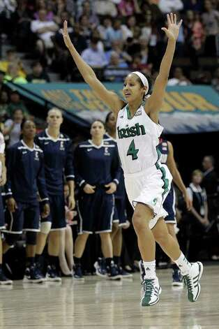 Notre Dame guard Skylar Diggins (4) celebrates victory after the NCAA women's Final Four semifinal college basketball game against Connecticut in Denver, Sunday, April 1, 2012. Notre Dame won 83-75. (AP Photo/Eric Gay) Photo: Eric Gay, Associated Press / AP