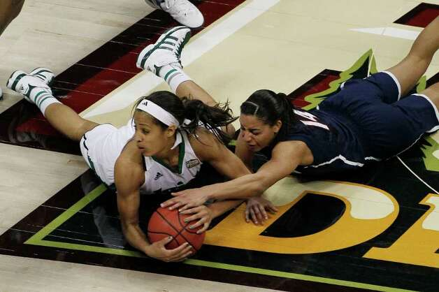 Notre Dame guard Skylar Diggins (4) and Connecticut guard Bria Hartley (14) vie for a loose ball during the second half of the NCAA women's Final Four semifinal college basketball game, in Denver, Sunday, April 1, 2012. Notre Dame won 83-75. Photo: David Zalubowski