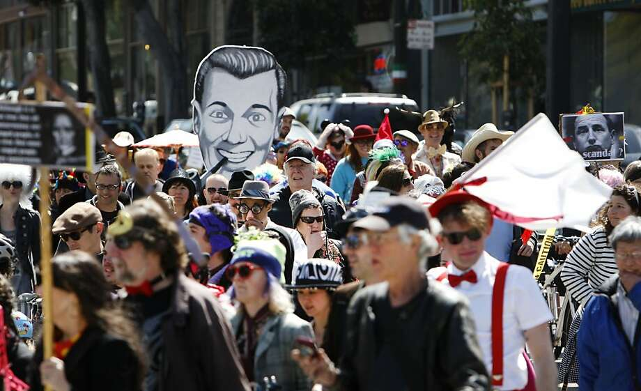 St. Stupid's Day parade marchers make their way along Columbus Ave towards Washington Square Park in San Francisco on Sunday during the annual April Fool's Day parade. People dressed in outlandish costumes marched along Montgomery and Columbus in San Francisco on Sunday afternoon for the 34th annual St. Stupid's Day Parade. The event was sponsored by the First Church of the Last Laugh. Photo: Kevin Johnson, The Chronicle