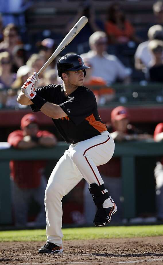 San Francisco Giants' Buster Posey in action against the Cincinnati Reds during a spring training baseball game on Saturday, March 31, 2012 in Scottsdale, Ariz. (AP Photo/Marcio Jose Sanchez) Photo: Marcio Jose Sanchez, Associated Press