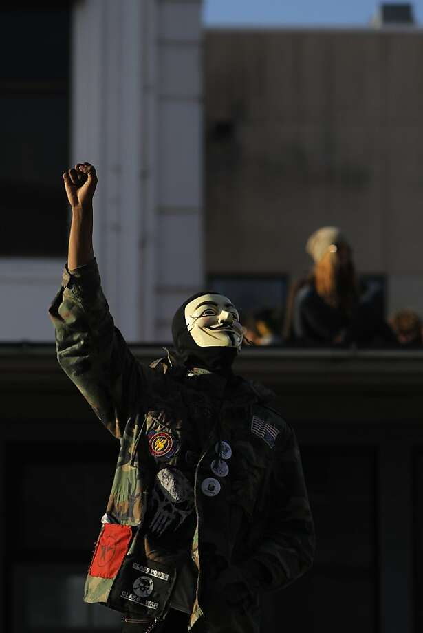 An Occupy San Francisco protester raises his fist in victory as his fellow protesters take over a building at the corner of Turk and Gough Streets in San Francisco, Calif., on Sunday, April 1, 2012, following a rally at Union Square and march up Geary. Photo: Carlos Avila Gonzalez, The Chronicle