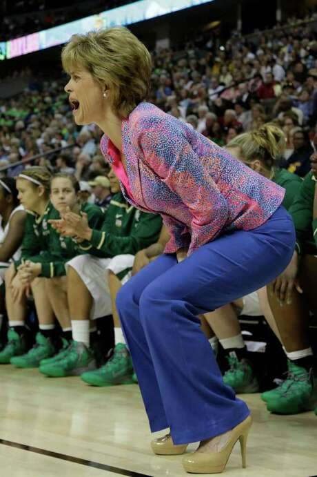 Baylor coach Kim Mulkey instructs her team during Sunday's first half. Photo: AP
