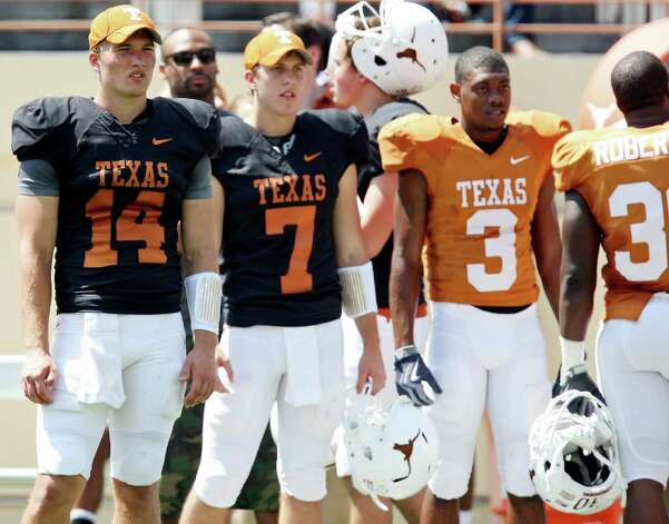 Texas' David Ash (from left), Connor Brewer and others watch first half action of the Orange-White Scrimmage held Sunday, April 1, 2012 at Darrell K. Royal Texas Memorial Stadium in Austin. The final score was Texas 35, Horns 27. Photo: EDWARD A. ORNELAS, San Antonio Express-News / © SAN ANTONIO EXPRESS-NEWS (NFS)