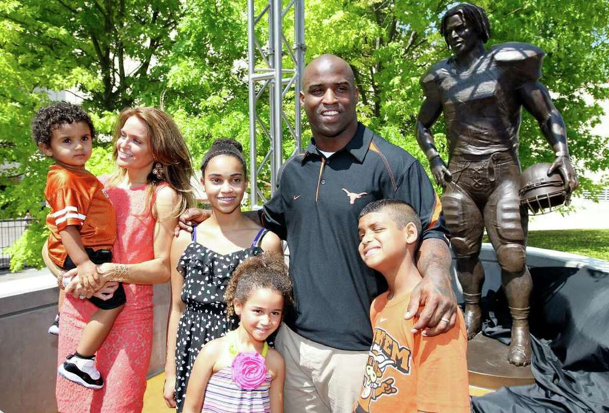 Former Longhorn and 1998 Heisman Trophy winner Ricky Williams poses for photos with his family during the unveiling of his statue before the Orange-White Scrimmage Sunday, April 1, 2012 at Darrell K. Royal Texas Memorial Stadium in Austin.