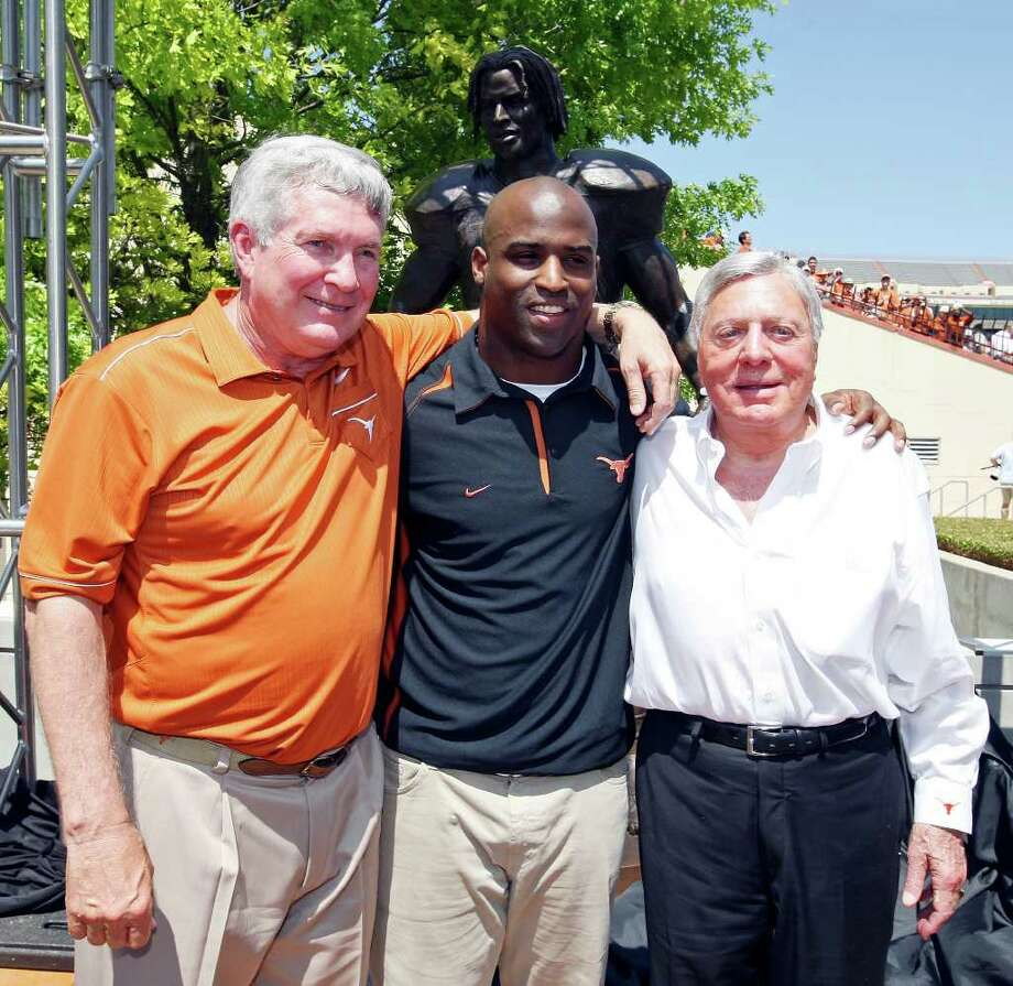 Former Longhorn player and 1998 Heisman Trophy winner Ricky Williams (center) poses for photos with Texas head coach Mack Brown (left), and UT alumnus Joe Jamail during the dedication of the Williams statue before the Orange-White Scrimmage Sunday, April 1, 2012 at Darrell K. Royal Texas Memorial Stadium in Austin. Photo: EDWARD A. ORNELAS, San Antonio Express-News / © SAN ANTONIO EXPRESS-NEWS (NFS)
