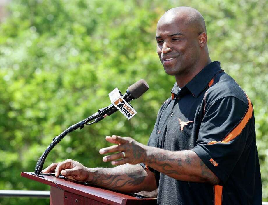 Former Longhorn and 1998 Heisman Trophy winner Ricky Williams speaks during the dedication of his statue before the Orange-White Scrimmage Sunday, April 1, 2012 at Darrell K. Royal Texas Memorial Stadium in Austin. Photo: EDWARD A. ORNELAS, San Antonio Express-News / © SAN ANTONIO EXPRESS-NEWS (NFS)