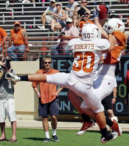 Texas' Cade McCrary catches a pass in the end zone for touchdown as he is defended by Ryan Roberts during second half action of the Orange-White Scrimmage held Sunday, April 1, 2012 at Darrell K. Royal Texas Memorial Stadium in Austin. Photo: EDWARD A. ORNELAS, San Antonio Express-News / © SAN ANTONIO EXPRESS-NEWS (NFS)