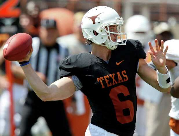 Texas' Case McCoy passes during first half action of the Orange-White Scrimmage held Sunday, April 1, 2012 at Darrell K. Royal Texas Memorial Stadium in Austin. Photo: EDWARD A. ORNELAS, San Antonio Express-News / © SAN ANTONIO EXPRESS-NEWS (NFS)