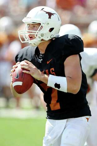Texas' Connor Brewer looks to pass during second half action of the Orange-White Scrimmage held Sunday, April 1, 2012 at Darrell K. Royal Texas Memorial Stadium in Austin. Photo: EDWARD A. ORNELAS, San Antonio Express-News / © SAN ANTONIO EXPRESS-NEWS (NFS)