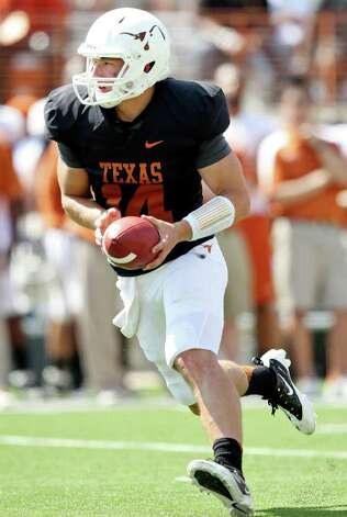 Texas' David Ash looks to handoff during second half action of the Orange-White Scrimmage held Sunday, April 1, 2012 at Darrell K. Royal Texas Memorial Stadium in Austin. Photo: EDWARD A. ORNELAS, San Antonio Express-News / © SAN ANTONIO EXPRESS-NEWS (NFS)