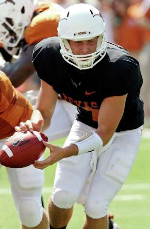 Texas' Connor Brewer tries to hold on to the football during second half action of the Orange-White Scrimmage held Sunday, April 1, 2012 at Darrell K. Royal Texas Memorial Stadium in Austin. Photo: EDWARD A. ORNELAS, San Antonio Express-News / © SAN ANTONIO EXPRESS-NEWS (NFS)