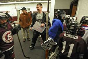 Dr. Wally Bzdell, a psychologist who's been working closely this season with the Union hockey team works with a youth hockey team at Union College Thursday March 29, 2012 in Schenectady, N.Y. (Lori Van Buren / Times Union)
