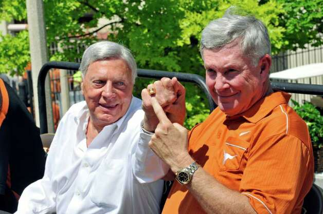 Texas coach Mack Brown (right) points to a Texas ring worn by attorney Joe Jamail before a ceremony dedicating a statue to former Texas running back Ricky Williams at the Orange and White spring football game, Sunday, April 1, 2012, in Austin. An athletic complex attached to the stadium is named after the famous Texas attorney. Photo: Michael Thomas, Associated Press